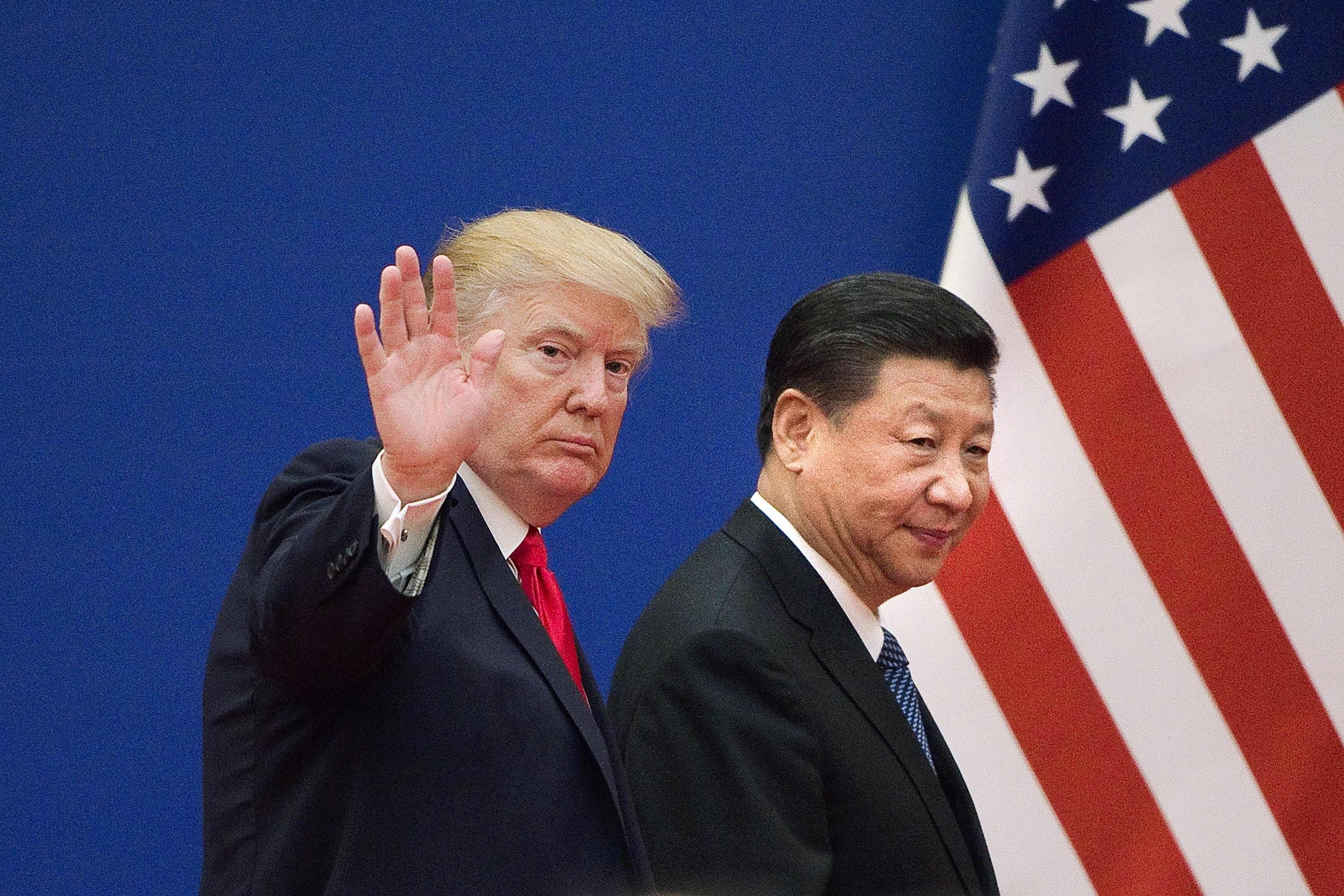 Imagen de archivo del 9 de noviembre de 2017 muestra al presidente de los Estados Unidos Donald Trump y al presidente de China Xi Jinping. (Foto: AFP)