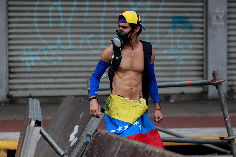 Manifestantes participan en una protesta contra el régimen de Maduro. (Foto: EFE)
